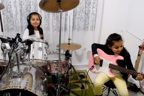 7 year old twin sisters cover Pink Floyd's 'Another Brick in the Wall'