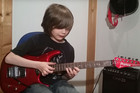 12-year-old boy absolutely nails this cover of Van Halen